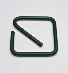 The SQ Trivet combines a primitive process and material - metal bending and steel - to create a contemporary and useful tabletop object. The trivet is manufactured in Rockford, Illinois and electropol