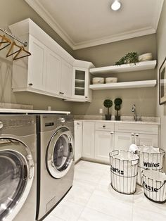 Beautiful Laundry Room. Spacious. Cabinets. Hanging rack. Sink. They added a counter on top of the washer and dryer. Room for ironing board.