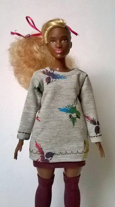 Printed gray curvy Barbie shirt with multi colored iridescent