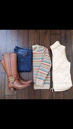 Cute fall outfit, especially the bubble vest. I LOVE THE PUFFER VEST. And the long boots.
