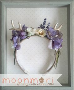 Handmade with polymer clay antlers and beautiful lavender faux flowers.