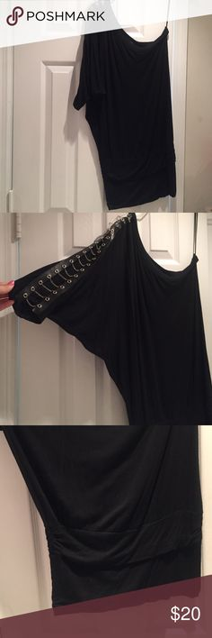 One sleeve black dress Loose fit one shoulder dress little sliver chains down the one sleeve tight around the bottom Body Central Dresses One Shoulder