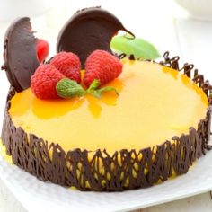 Mango Mousse Cake with a great looking chocolate Genoise. Try our Mango Mousse Cake recipe, the recipe here and prepare to impress your family and friends. Mango Mousse Cake, Mango Cheesecake, Mango Cake, Cheesecake Recipes, Dessert Recipes, Best Mango Mousse Recipe, Fancy Desserts, Just Desserts, Delicious Desserts
