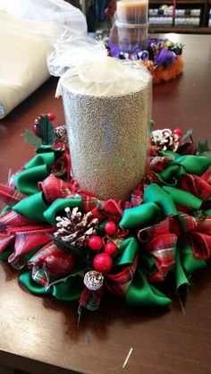 Small ribbon wreath in can be used for a pillar candle ring.  Here, I used traditional Christmas colors.