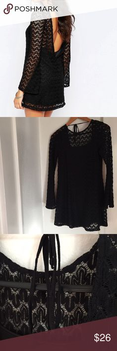"""Motel smokey bell sleeve dress in crochet lace Black crochet dress with long flared sleeves, round neck and scoop back in a gorgeous wave lace. The dress is lined only flaw is the stitching on tie closure is separating.(shown in picture three) Shoulder seam to hem measures approx 31"""" in length. Motel Rocks Dresses"""