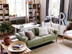 I like the bookcases on wall; I like the desk directly behind sofa