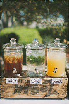 This line-up of refreshing summer drinks have our mouths watering for the sweet taste of summer. A station of beverage dispensers adds a quaint touch.Related: Signature Cocktails for Summer Weddings
