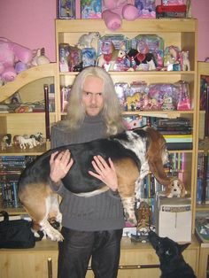 Creepy dude with the worlds saddest basset hound and a my little pony collection.