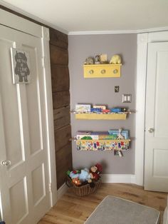 Bookshelves and stuffed animals. The only thing left is for hubby to cover the electrical outlets!