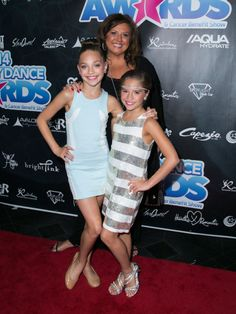 Maddie Ziegler made a public appearance with her sister, Mackenzie Ziegler, and dance coach, Abby Lee Miller, at the Industry Dance Awards 2014 [2014]