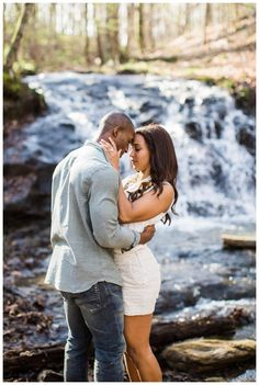 Summer engagement photo ideas. Couple at creek with waterfall, image by Simply Sarah Photography.