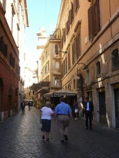 An old couple walking through Rome
