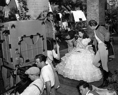 """Behind the scenes peek at 'Scarlet' touching up before the filming of the scene from """"Gone With the Wind"""""""