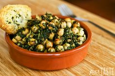 Espinacas con Garbanzos, a Spanish dish of spinach and chickpeas, is very common in Andalucía and the south of Spain. This recipe utilizes typical Spanish spices and flavors to develop and unexpectedly rich dish given the simplicity of its ingredients.