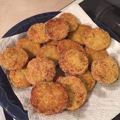Ingredients : 4 large green tomatoes 2 eggs 1/2 cup milk 1 cup all-purpose flour 1/2 cup cornmeal 1/2 cup bread crumbs 2 teaspoons coarse kosher salt 1/4 teaspoon ground black pepper 1 quart vegetable oil for frying Directions : Slice tomatoes 1/2 inch thick. Discard
