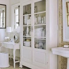 I'm in love with this cabinet for a bathroom.