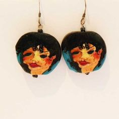 Nineties modernist art face pierced earrings for a woman Turquoise and black vintage drop earrings that have a squashed Japanese face style