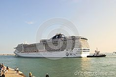 The arrival of a massive cruise ship for la biennale in S. Mark's basin, in Venice, Italy, Europe