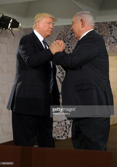 U.S President Donald Trump (L) shakes hands with Prime Minister of Israel Benjamin Netanyahu (R) during his visit to Israel Museum in Jerusalem on May 23, 2017.