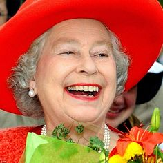 All smiles! Queen Elizabeth II is pictured enjoying a walk about, after visiting the Old Government House in Fredericton, New Brunswick, on October 11, 2002, during her two week Royal visit to Canada
