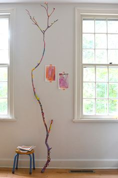 Collect branches, or just one branch, from outside and use tempera paints for a collaborative art experience for kids.