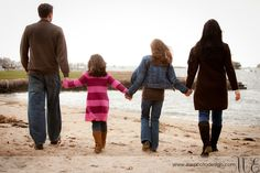 Beach portraits don't only take place in the summer! Take your family to the beach in the fall or winter for some awesome shots!
