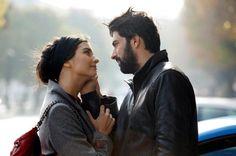 Tuba Buyukustun as Elif and Engin Akyürek as Ömer in the Turkish TV series KARA PARA ASK, 2014-2015.