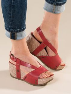 Step up to wedge-heeled fun in Women's Bussola Sun Chaser Sandals. Leather shoes with basket-weave wedges have thong-style toe posts for comfort. Get yours now!