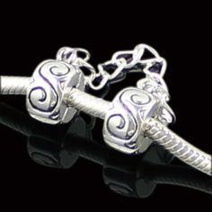 Silver Plated With Black Sculpture Safety Chain fits European Charm /Pandora Bracelets. $4.99, via Etsy.