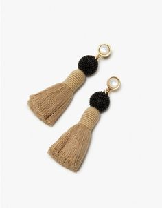 Drop earrings from Lizzie Fortunato.. Mother of pearl studs black seed beaded detail and linen fringe tassels. Post back with clutch closure. Made in USA with imported materials. Sold as a set.    • Gold-plated brass  • Linen tassels  • Made in USA