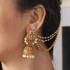 Add a little glam to your Indian wedding outfit by wearing these chic earrings. You can pair these trendy and classy earrings with any ethnic attire. OTT earrings will surely take your reception/haldi/mehndi/wedding outfit a notch higher. Gold Jhumka Earrings, Jewelry Design Earrings, Gold Earrings Designs, Gold Jewellery Design, Ear Jewelry, Bridal Earrings, Gold Jewelry, Jewelery, Jhumka Designs