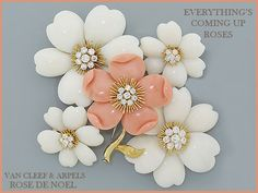 Van Cleef & Arpels   Rose de Noel brooches and earrings in coral, diamonds, and 18k