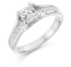 Channel Set Diamond Ring With A Round Brilliant Diamond Majestically Mounted On A Four Claw Mount With Beautifully Princess Cut Shoulders Sweeping Away. Round Cut Diamond, Diamond Cuts, Diamond Jewelry, Gold Jewelry, Jewellery, Princess Cut Diamonds, Stone Rings, Engagement Rings, Bling Wedding