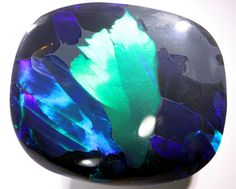 58.80 CTS  NEON BRIGHT LIGHTNING RIDGE OPAL .   This is a solid natural  opal mined in Lightning ridge.This stone has a beautiful bright  neon green pattern. It is showing a stunning display  of BLUE GREEN This stone is suited to a bracelet or pendant.
