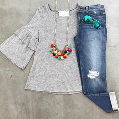 Jeans, gray long sleeved tee, colorful tassel necklace