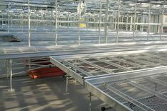 Benches | Bridge Greenhouses These benches raise the crop off the floor, allowing easier access. Our static and rolling benches can be fitted with a number of different bases to suit the growers irrigation/ventilation requirements – e.g. ebb and flood liners, mesh base or a solid surface. We can also fit specialised tops for potting areas or laboratories etc. Our bench legs can be made using either galvanised steel or aluminium, with various options for height adjustment. Bench Legs, Solid Surface, Greenhouses, Galvanized Steel, Irrigation, Bridge, Rolls, Mesh, Suit