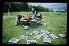 Otis Tamasaukuas printing with an intaglio press in Gros Morne, Newfoundland. Working on project, Progress of Walking and field Notes.