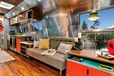 The interior of a 1962 Airstream trailer customized in midcentury modern style.