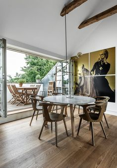 Beautiful dining area with stunning home-built dining table in wood and marble. A fun touch with the 1 x 1 m brass plates of Brigitte Bardot on a horse.