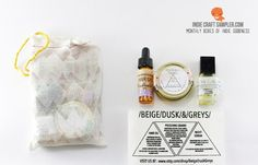 """Beige Dusk Greys sent in 50 cloth bags each with samples that include hair oil, polishing grains, and """"the cure"""" night time face serum.___________________________ Indie Craft Sampler- A monthly subscription box filled with handmade goods and samples from indie businesses from around the world.  http://www.indiecraftsampler.com  #handmade #beauty #hairoil #serum #monthlysubscriptionbox #samplerbox #samples"""