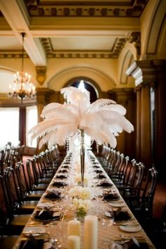 I could totally see myself having a 1920s old hollywood glam wedding.  Love the feather centerpieces!