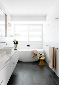 Today we take you on a seriously fun home tour! With pops of colour around every corner, this is a functional family home that is sure to excite and inspire Grey Bathroom Floor, White Bathroom Tiles, Bathroom Plants, Dark Grey Bathrooms, Bathroom Tile Colors, Tile Bathroom Floors, Gray And White Bathroom Ideas, Classic White Bathrooms, Small White Bathrooms