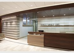 Horizontal lines are the dominant design element in this Reception Area designed by Burkett Design