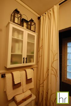 bathroom wall cabinet : lanterns on top of cabinet!