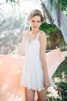 braided crown hairstyle, white dress, and spring pastel palette