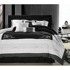 @Overstock - Add a delicate touch to your bedroom decor with this elegant comforter set. Featuring swirling scroll embroidery atop a black and white background, this delightful set is finished with a diamond quilted comforter center.http://www.overstock.com/Bedding-Bath/Florence-Black-White-Queen-size-Oversized-8-piece-Comforter-Set/6460915/product.html?CID=214117 $84.99