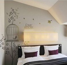 bedroom wall decor...love the birdcage!