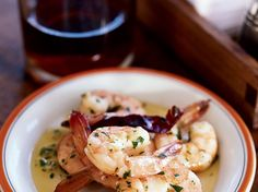 Garlicky Shrimp with Olive Oil | At La Casa del Abuelo, a tiny taberna in Madrid, gambas al ajillo (shrimp with garlic) are cooked in individual earthenware cazuelitas and served with...
