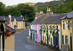 Located on the east coast of Ireland, Avoca is a pretty village in County Wicklow. It is home to the famous Avoca Hand Weavers. It is particularly well-known as the site of the Ballykissangel series. Fitzgerald's Pub is in the foreground.