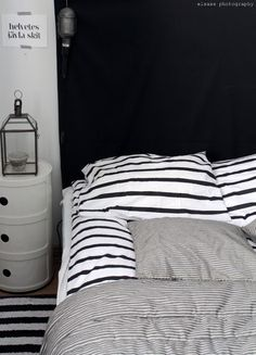Black and white Stripes on bed. This is my kind of room. I love stripes.